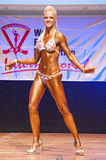 Female figure model shows her best at championship on stage Royalty Free Stock Photo