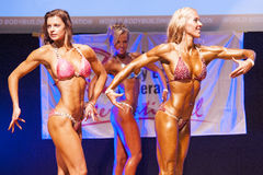 Female figure model shows her best at championship on stage Stock Photography