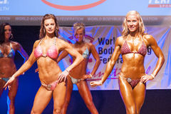Female figure model shows her best at championship on stage Stock Images