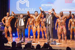 Female figure model shows her best at championship on stage Stock Photo