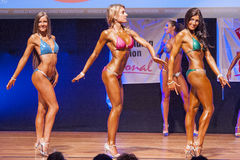 Female figure model shows her best at championship on stage Stock Image