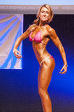 Female figure model shows her best at championship on stage Royalty Free Stock Images