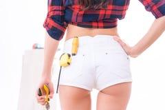 Female figure with repairing utensils Stock Photo
