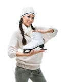 Female figure skater hands one skate Royalty Free Stock Photos