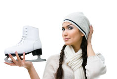 Female figure skater pensively looks at the skate Stock Images