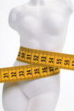 Female figure with a yellow measuring tape. On a waist Royalty Free Stock Images