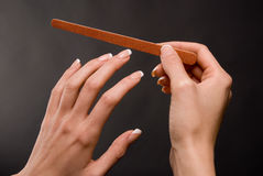 Female filing nails Stock Image