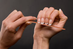 Female filing nails Royalty Free Stock Photography