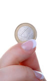 Female finger with one euro coin Royalty Free Stock Photo