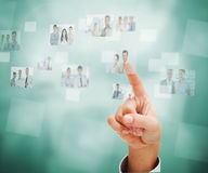 Female finger pointing at futuristic interface. Showing business people Stock Images