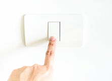 Female Finger press on light button Stock Images