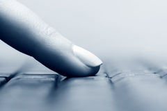 Female finger typing on computer keyboard Royalty Free Stock Image