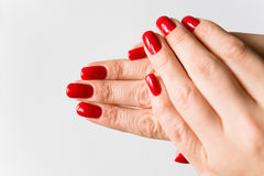 Female fingers with a beautiful manicure. Nails are covered with red lacquer royalty free stock photos