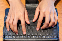 Female fingers typing on keyboard Royalty Free Stock Photo