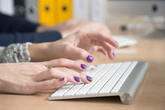 Female fingers typing on keyboard Stock Images