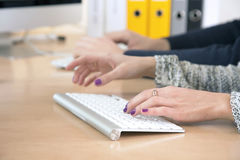 Female fingers typing on keyboard Royalty Free Stock Photography
