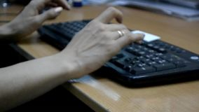 Female fingers typing on keyboard.