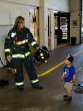 fireman and little boy Royalty Free Stock Photos