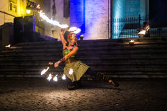 Female fire show performer Royalty Free Stock Images