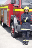 Female firefighter. Portrait of female firefighter outside fire engine Royalty Free Stock Photos