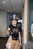 Female firefighter completing stair climb event. Female firefighter at the Scott Columbia Tower firefighter stair climb event raising funds for leukemia cure stock photo
