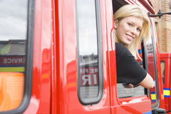 Female firefighter sitting in the cab. Of a fire engine royalty free stock image