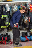 Female Firefighter Wearing Uniform At Fire Station Royalty Free Stock Photo
