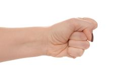 Female fist. A female fist shows aggression Stock Photos