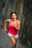 Female fit athlete running Royalty Free Stock Photos