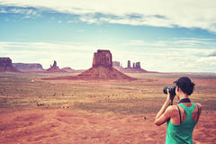 Female fit photographer takes pictures in Monument Valley, USA. Stock Image