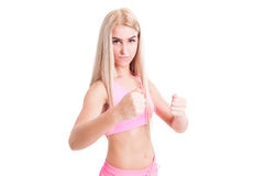 Female fitness or aerobics trainer in fighting position Stock Photography