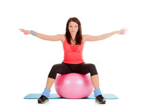 Female with fitness ball and dumbbells in sport center Royalty Free Stock Photo