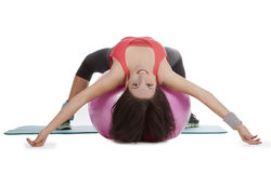 Female with fitness ball in stretching Royalty Free Stock Images