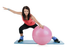 Female with fitness ball in stretching Stock Images