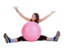 Female with fitness ball in stretching Royalty Free Stock Image