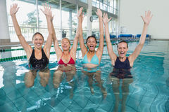 Female fitness class doing aqua aerobics and cheering Royalty Free Stock Images