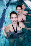 Female fitness class doing aqua aerobics. In swimming pool Royalty Free Stock Images