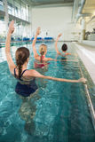 Female fitness class doing aqua aerobics Stock Images
