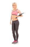 Female fitness coach holding a clipboard Stock Images