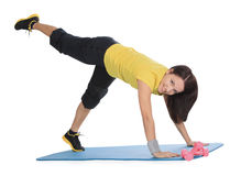 Female with fitness dumbbells does exercise Stock Photography