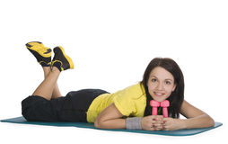 Female with fitness dumbbells in sport center Royalty Free Stock Photo