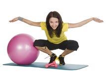 female with fitness dumbbells in sport center Stock Photo