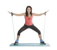 Female with fitness expander in stretching Royalty Free Stock Photo