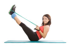 female with fitness expander in stretching Stock Photography