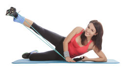 Female with fitness expander in stretching Stock Photos
