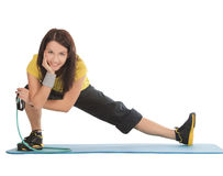 Female with fitness expander in stretching Stock Photo