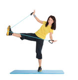 Female with fitness expander in stretching Royalty Free Stock Photography