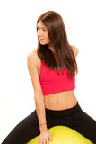 Female fitness instructor with gym ball Royalty Free Stock Photography