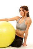 Female fitness instructor with pilates ball Stock Images