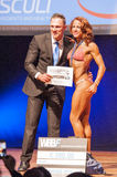 Female fitness model celebrates her victory on stage Royalty Free Stock Photos